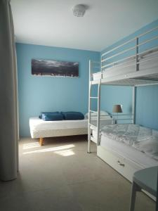 A bunk bed or bunk beds in a room at La Conchee