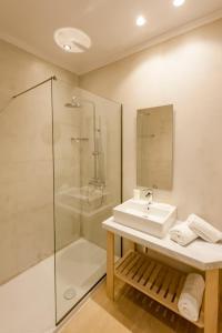 Een badkamer bij Village