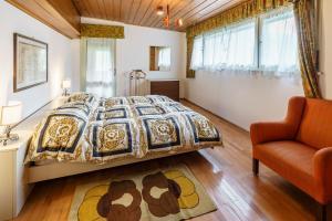 Un pat sau paturi într-o cameră la Villa Ca Bonel - Stayincortina