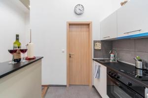 A kitchen or kitchenette at Historical building Brody Apartment