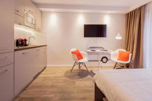 A seating area at Brera Serviced Apartments Frankfurt