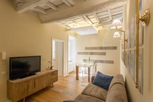 Uma área de estar em Boschetto 124 Apartment