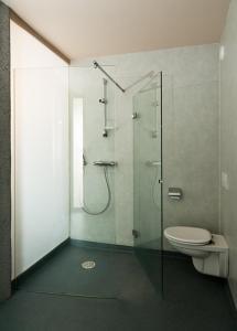 Een badkamer bij Quatre Mains Serviced Apartments
