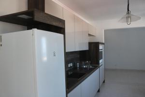 A kitchen or kitchenette at 3C Fuerteventura