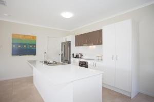 A kitchen or kitchenette at Petrie Beach Holiday Home