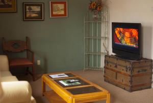 A television and/or entertainment center at Sunnyvale Garden Suites - Joshua Tree National Park