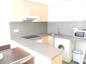 A kitchen or kitchenette at Apartamentos Rio de la Plata