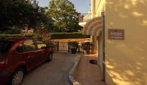 The facade or entrance of Bacan Serviced Apartments