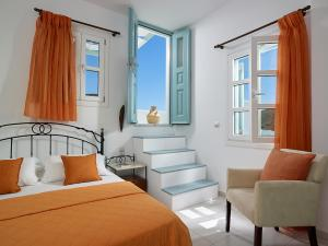 A bed or beds in a room at Asterias Boutique Hotel