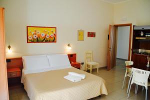 ห้องพักของ Caposud Residence and Beach Club