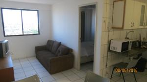 A seating area at Sky apartamento II