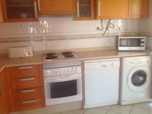 A kitchen or kitchenette at AlturaMar