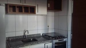A kitchen or kitchenette at Flat Studio Iracema