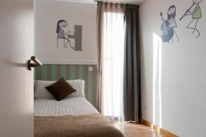 A bed or beds in a room at MH Apartments Liceo