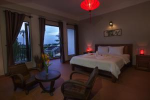 Una habitación en GEM Hoi An Villa