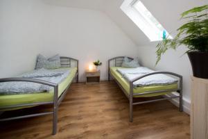 Ein Zimmer in der Unterkunft Ferienwohnung am Horstsee