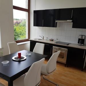 A kitchen or kitchenette at Rue masure
