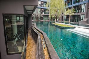 The swimming pool at or near Acqua Condominium By Mr.Butler