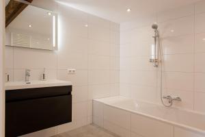 Een badkamer bij Ruyge Weyde Logies