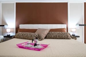 Letto o letti in una camera di Quattro Canti Apartments