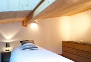 A bed or beds in a room at Quartz-Montblanc
