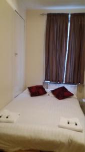 Cama ou camas em um quarto em Mayfair Flat