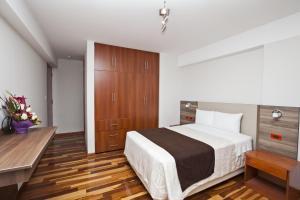 Una habitación en Polo Apartaments