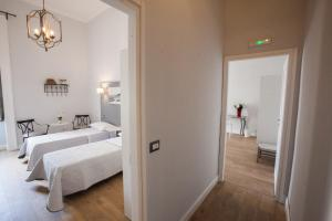 A bed or beds in a room at Largo Donnaregina Home