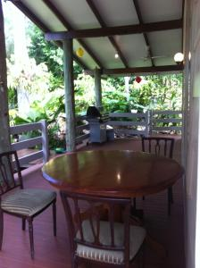 A porch or other outdoor area at Airlie Coral
