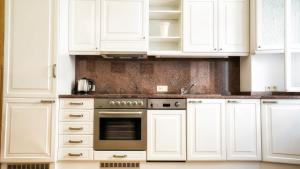 A kitchen or kitchenette at Apartment by the Old Town Square