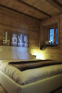 Letto o letti in una camera di Appartamento Le Chalet