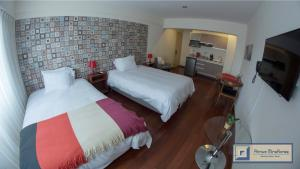 A bed or beds in a room at Atrium Miraflores Hotel
