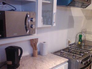 Una cocina o zona de cocina en Departamentos Rohe