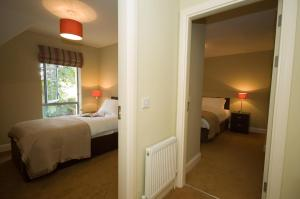 A bed or beds in a room at Kenmare Bay Hotel Holiday Homes