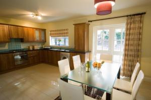 A kitchen or kitchenette at Kenmare Bay Hotel Holiday Homes