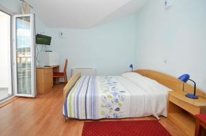 A bed or beds in a room at Apartments Villa Lida