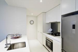 A kitchen or kitchenette at Abode 316