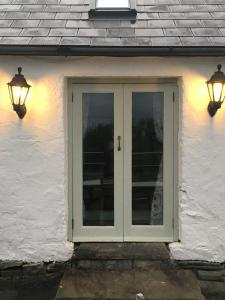 The facade or entrance of Kilshanny Milk Parlour Cottage