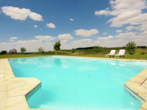 The swimming pool at or near Luxorious Mansion in Saint-Preuil with Sauna