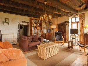 The lounge or bar area at Cozy Cottage in Aquitaine with Fireplace