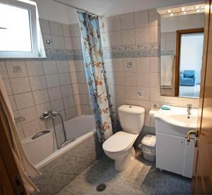 A bathroom at Nephele Apartments