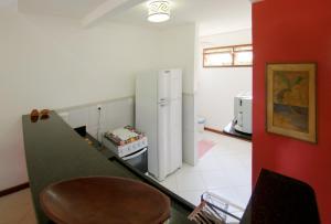 A kitchen or kitchenette at Manacá Flat