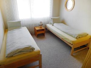Ein Zimmer in der Unterkunft Apartment Parkhotel Arvenbühl.1