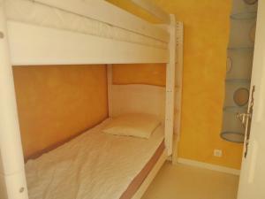 Un ou plusieurs lits superposés dans un hébergement de l'établissement Apartment Cimes