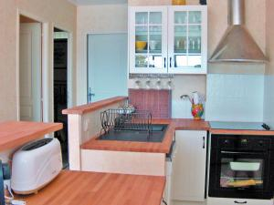Cuisine ou kitchenette dans l'établissement Apartment Cimes