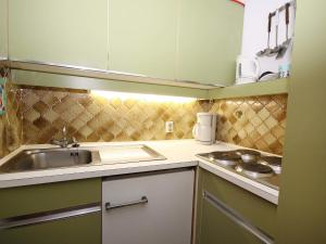 A kitchen or kitchenette at Apartment Point.1