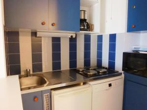 A kitchen or kitchenette at Apartment Acapulco.2