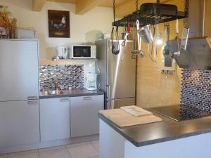 Küche/Küchenzeile in der Unterkunft Chalet Le Bon Appart