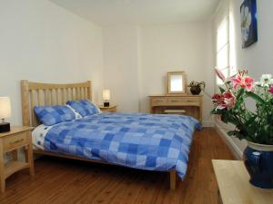 A bed or beds in a room at Holiday Home Ballyhass Lakes.1