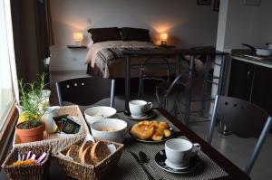 Una cama o camas cuchetas en una habitación  de El Chalten Aparts